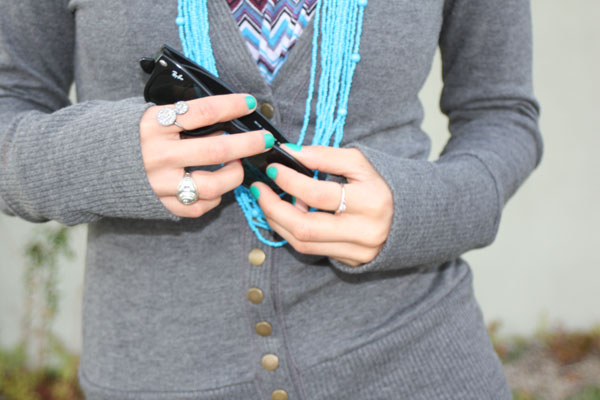 gray-sweater-closeup-rayban-turquoise-necklace
